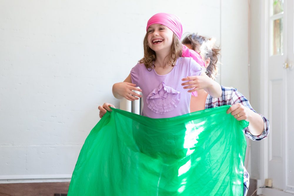 5 year old in fun creative theatre class playing dress up