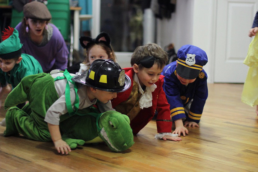PreK children in costume playing acting games