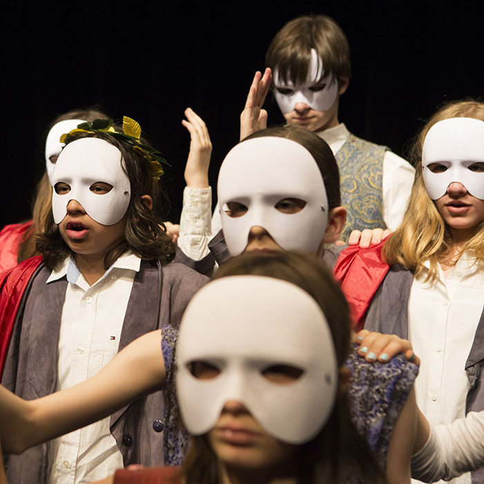 11-15 year olds performing shakespeare in costumes at theatre class