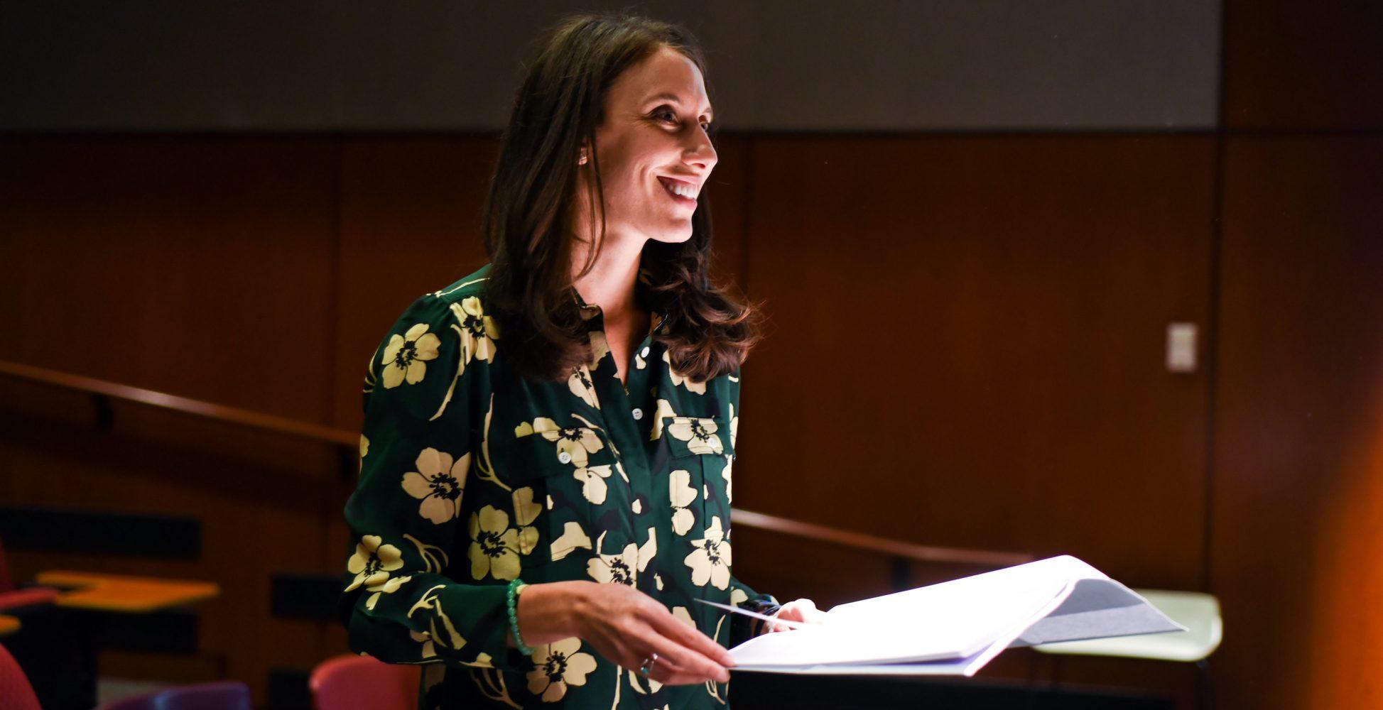 Jocelyn Greene smiles with script