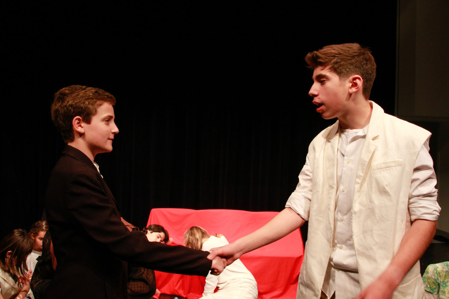 middle school and high school kids perform in theatre class