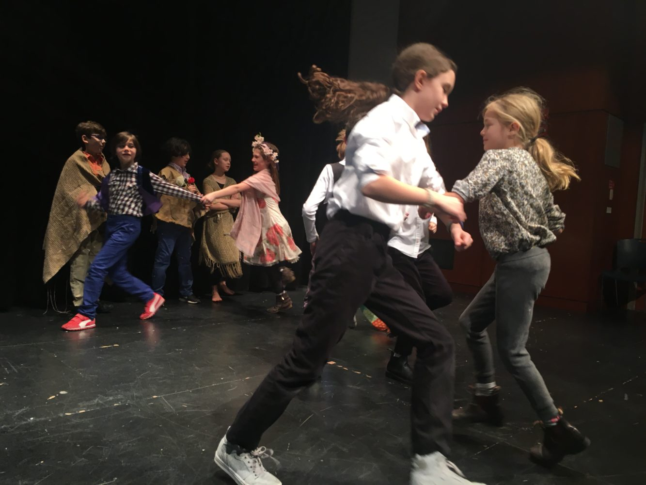 middle school students rehearse and perform shakespeare for theatre class on stage