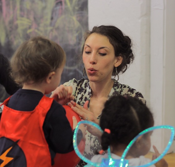 3-6 year olds in costumes learning and playing at after school theatre class