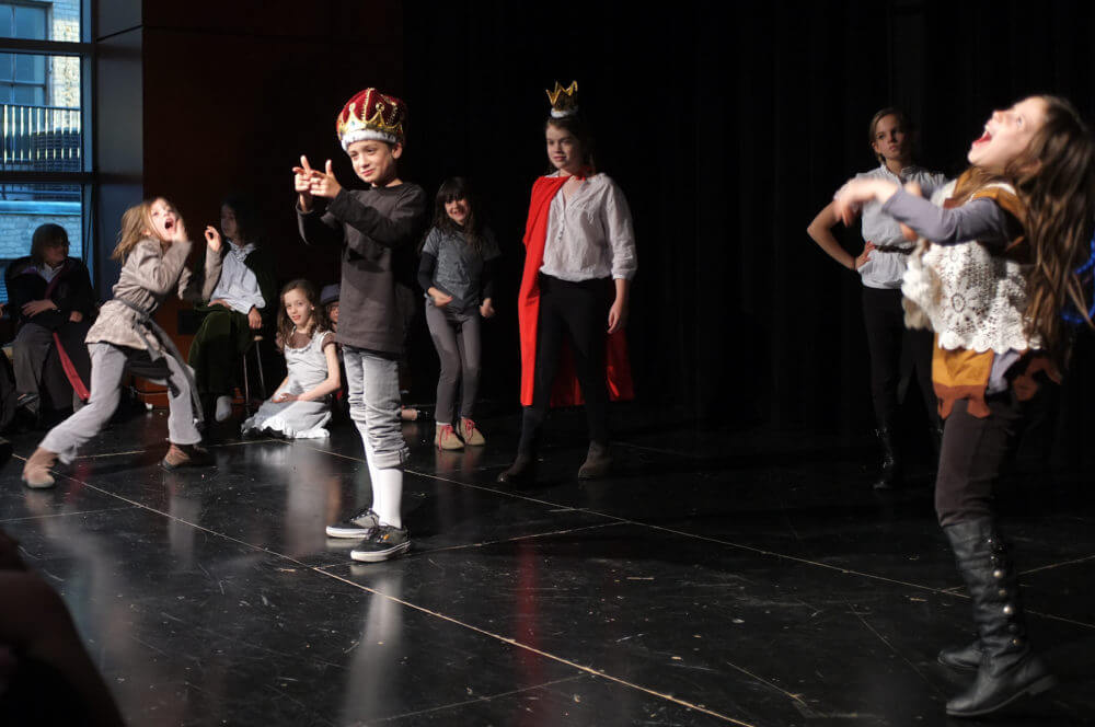 Children performing Shakespeare in costume