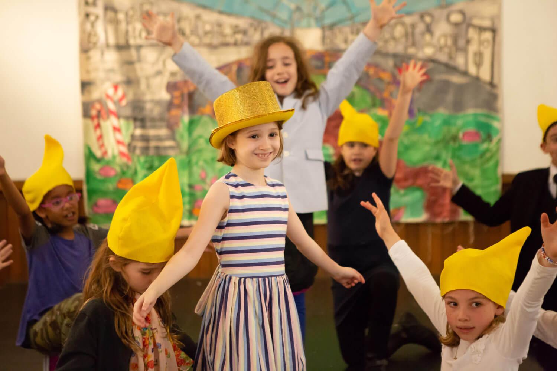 Children performing in costume