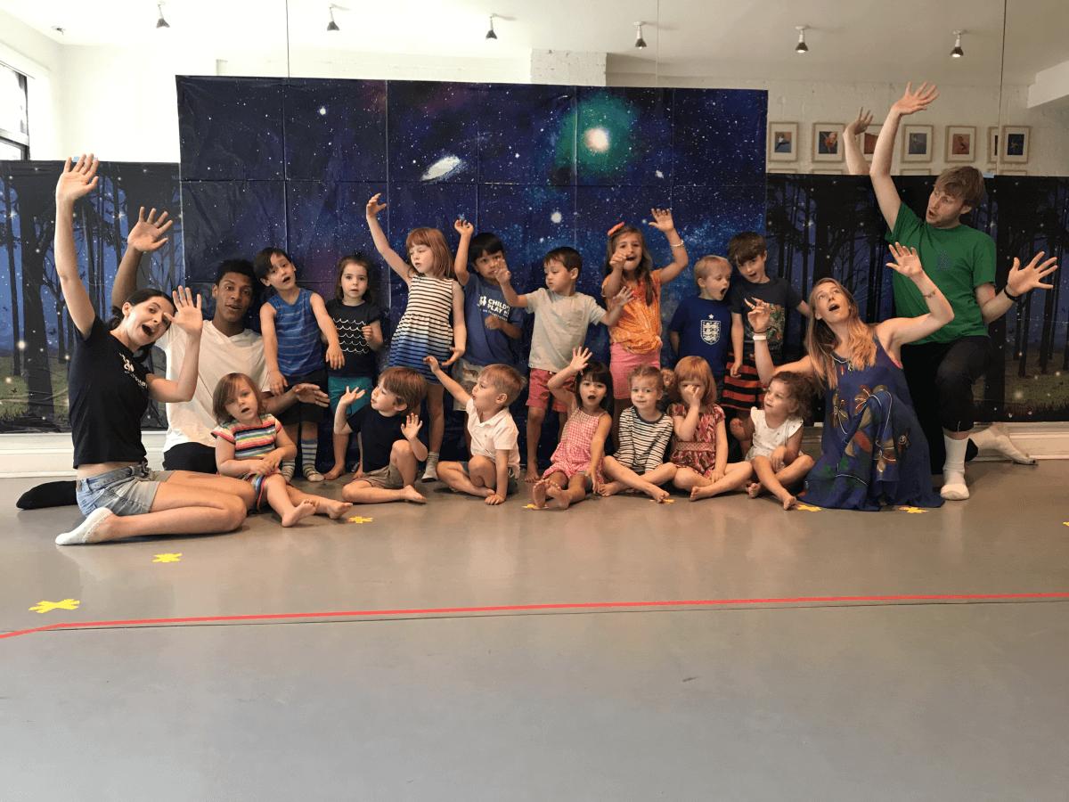 Preschool summer camp kids enjoying theater camp alongside teachers